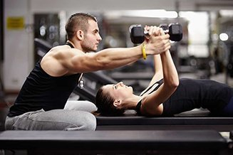 Personal Trainer Working with a member